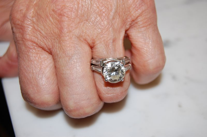 Round Brilliant Engagement Ring with Tapered Baguette Side-stones