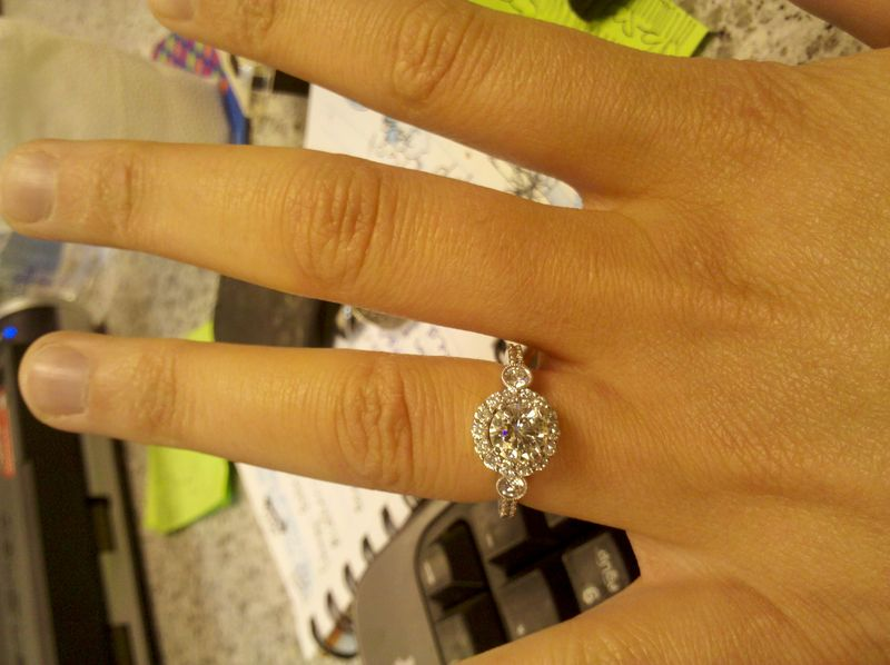 Three Stone Round Brilliant Engagement Ring with Halo Setting