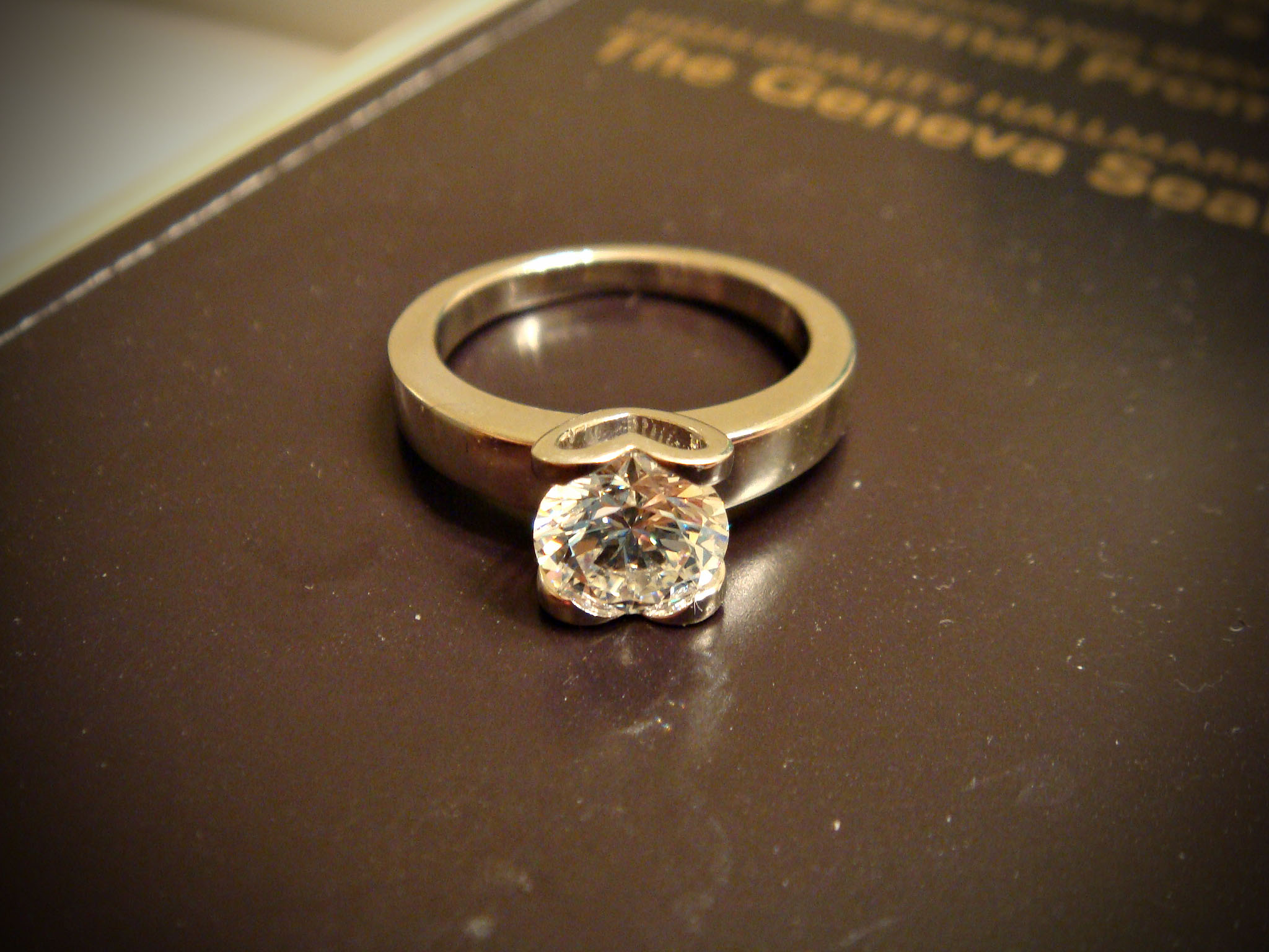 round brilliant engagement ring with heart shaped prongs wedding
